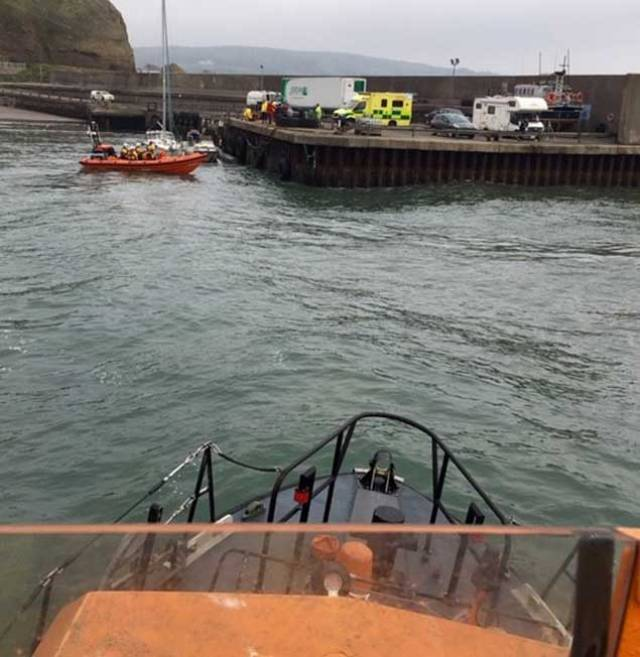 A 28ft yacht on passage from Oban in Scotland to Belfast got into difficulty when its five-person crew became ill in challenging sea conditions