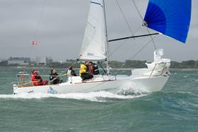 Find our Afloat.ie readers a hint of sun, and we'll put you top of the page..... Ciaran White's immaculately-maintained Scandal is one of the J/24s dominating Class 4, and she currently lies second overall