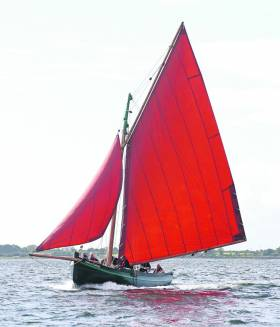 With her staysail stowed as she approaches the pier in Kinvara, the Croi an Cladaig is a handsome 2012 example of the traditional boats being built by Badoiri na Gaillimh in the heart of Galway City