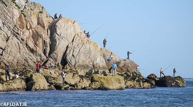 Anglers perched on the rocks on the Dalkey coastline