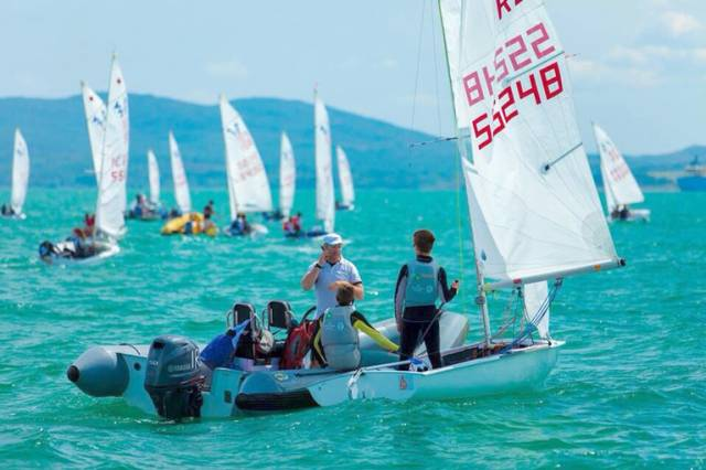 Irish Sailing Coach Ross Killian with a fleet of 420 dinghies