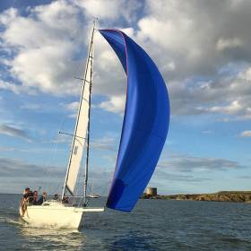 One of Howth YC's club-owned J/80s coming through the sound inside Ireland's Eye. The HYC-owned flotilla is well booked for the current season, and five fully-crewed Howth club-owned J/80s will be taking part in the Volvo Dun Laoghaire Regatta in July. Photo: Emmet Dalton