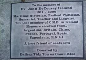 The plaque dedicated to the memory of the work of the late Dr. John de Courcy Ireland is located at Coliemore Harbour, Dalkey where he was a resident of the Dublin suburb