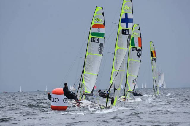 Matt McGovern and Robbie Gilmore, one of six Irish boats competing, round a leeward mark just ahead of Finland and India at Kiel Week