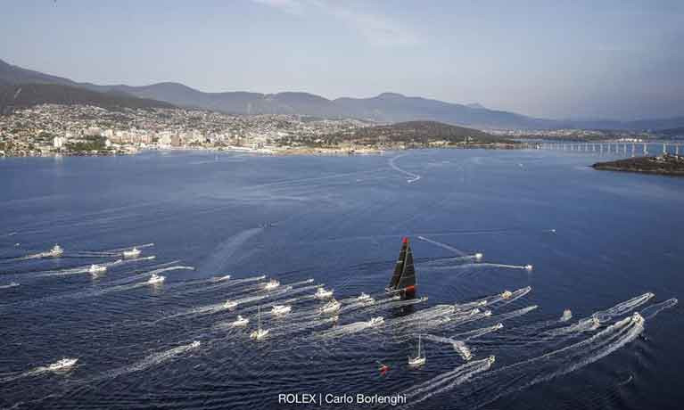 Comanche made the final dash to the Rolex Sydney Hobart finish line contending with fickle breeze ahead of the other four super maxis