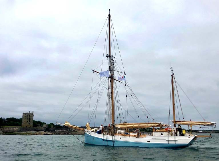 The restored 1926 ketch Ilen takes her departure for Greenland from the MacMahon stronghold of Carrigaholt Castle on the Shannon Estuary