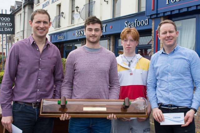 (From left) Regatta organiser Charles Dwyer (and fouth overall) with Darragh O'Sullivan with the Yard of Ale trophy. Chris Bateman second overall and first Junior and Ronan Kenneally first Master and third Overall at the Monkstown Bay Laser League prizegiving
