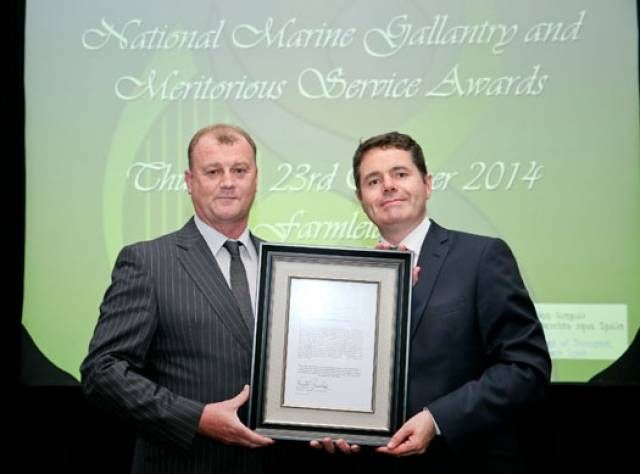 National Marine Gallantry and Meritorious Service Awards presented by the then Minister for Transport, Tourism and Sport Paschal Donoghue held in Farmleigh House in Dublin. Pic shows Minister for Transport, Tourism and Sport Paschal Donoghue with Mr Jim Griffin who received the Marine Ministerial Letter of Appreciation for Meritorious Service For acting on his initiative in realising that he was the nearest trained asset to assist with rescuing 7 people at Tramore Bay in August 2013 who were cut-off by the tide