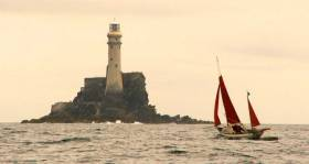 Jack O'Keeffe leads a race of Drascombes around the Fastnet Rock