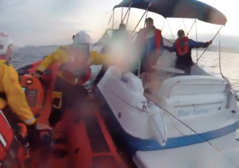Bangor's lifeboat comes alongside the stricken motorboat in Belfast Lough