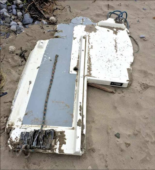 Wreckage from the Westerly on Claremont Beach in Sutton. A hull plate Number ST2 is visible