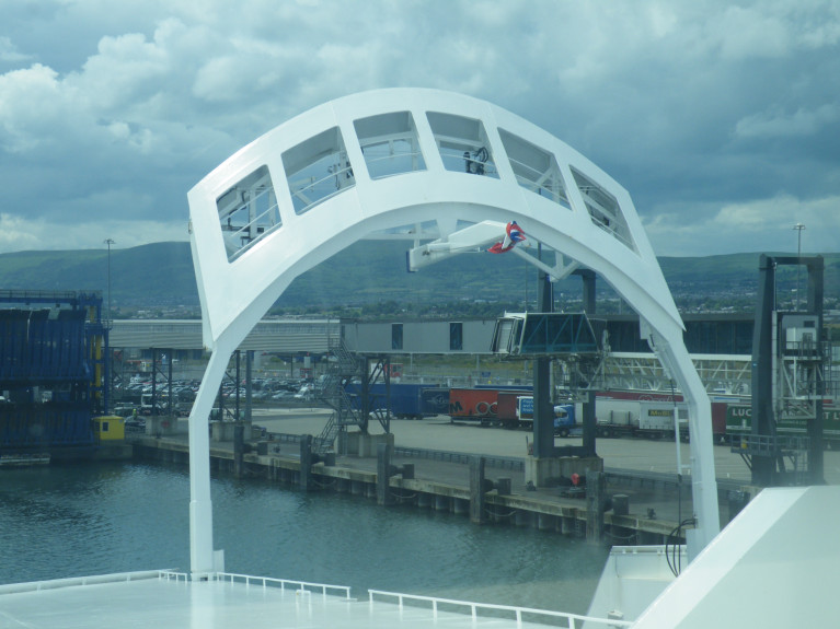 Britain-NI trade: The 'goods at risk' issue has proven highly sensitive in talks between the EU and the UK. Above AFLOAT adds in the raised position is the upper bow 'gate' visor of a ferry while in Belfast Harbour where freight-trailers can be seen on the quayside.