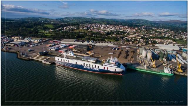 Warrenpoint Port, Co. Down is inviting members of the public and stakeholders to make comments and views on a dredging proposal. Above Afloat adds is Seatruck's newly introduced Seatruck Performance a FSG / 'Heysham-max' class ro-ro freightferry which operates to the Lancashire port. Ahead of the ro-ro ferry is an Arklow Shipping R class short-sea trader.