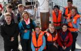 BBC 1 Songs of Praise Presenter Claire McCollum with the young cross border crew on the Brian Boru in Carlingford Lough.