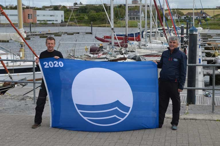 Marina Manager Simon McGibney (left) and Blue Flag project manager George McGibney with one of two new Blue Flags for Kilrush Marina and Portmagee Pontoon