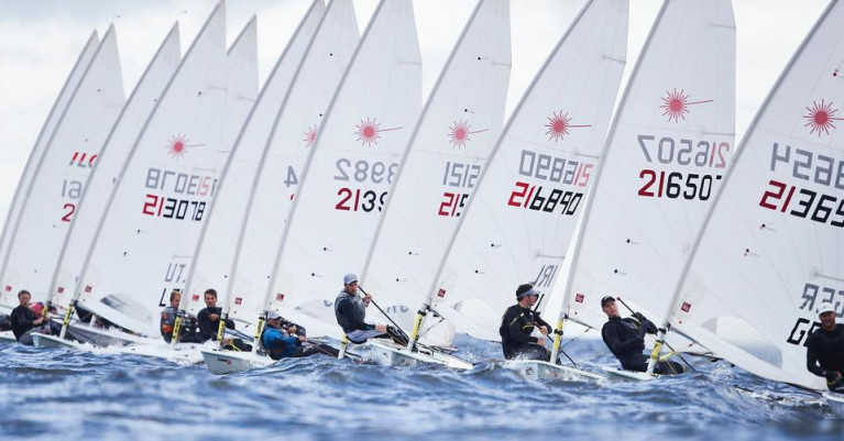 Finn Lynch (216890) and Liam Glynn (216507) next to each other on day two of the Laser Europeans in Poland
