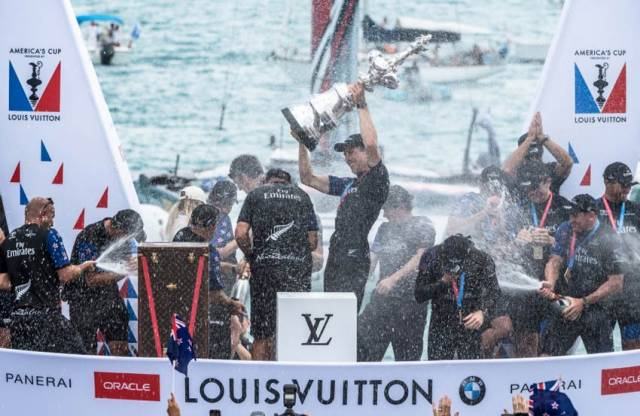 Peter Burling and crew raise the Auld Mug aloft after their victory in the 35th America's Cup in Bermuda on Monday 26 June