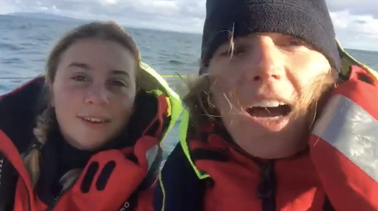As merry as grigs – Cat Hunt and Pam Lee in cheerful mood early this morning as their Figaro 3 Iarracht Maigeanta rides on the flood tide with a good breeze past Rathlin Island, with Islay distant on the horizon
