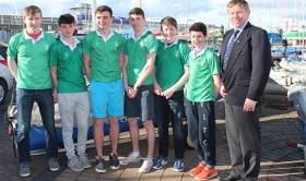 Leinster Schools Team Racing Winners Gonzaga College SJ with (right) Frank O'Beirne of the Royal St. George Yacht Club