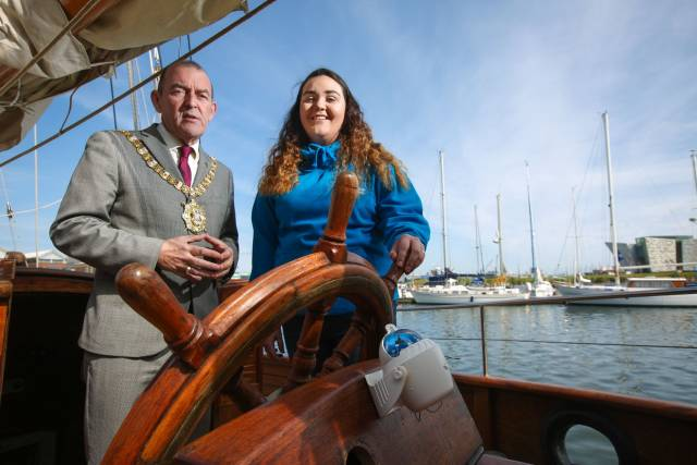 Belfast Lord Mayor Councillor Arder Carson with one of the tallship volunteers, Niamh Macklin from Bryson Future Skills on board the Maybe