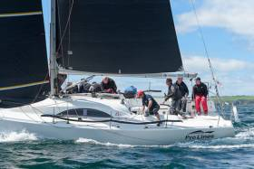Black is beautiful – and fast. Rob McConnell's A35 Fool's Gold (Waterford Harbour SC) powers her way to a clean sweep of the Sovereigns Cup at Kinsale last week with the latest in UK McWilliam sails. Graham Curran of the sailmakers is trimming the headsail