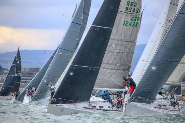Overall leader White Mischief (1242) makes a start near the pin end in the fourth race