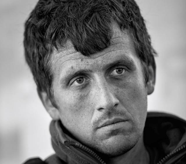The stressed face of the lone skipper. This is Tom Dolan at the briefing in Pornichet before his first major single-handed race in 2015, in which he would sail a borrowed and far-from-new Pogo 650 Mark 2. Two days before the start, he had discovered a fractured spreader bracket on the mast. To fix it, he had to take down the mast, drive to La Rochelle for a replacement bracket, fit it, and then re-step the mast on the night before the race. That final stage was completed with the help of ten fellow-skippers, typical of the camaraderie of the Mini 650 class