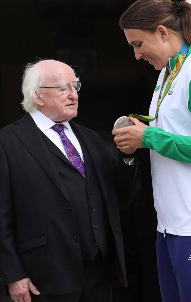 President Michael D Higgins congratulates Annalise Murphy on her Olympic Silver medal