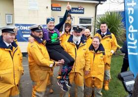 Arklow RNLI crew help Mary Nolan Hickey take a load off after she crossed the finish line yesterday