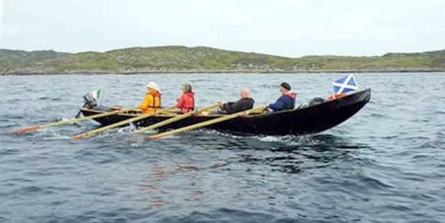 Voyage with a purpose – Danny Sheehy's currach making purposeful progress through the Hebrides during the first of his pilgrimage voyages, delivering an Irish Bible from Kerry to the Abbey founded by St Columba at Iona in Scotland