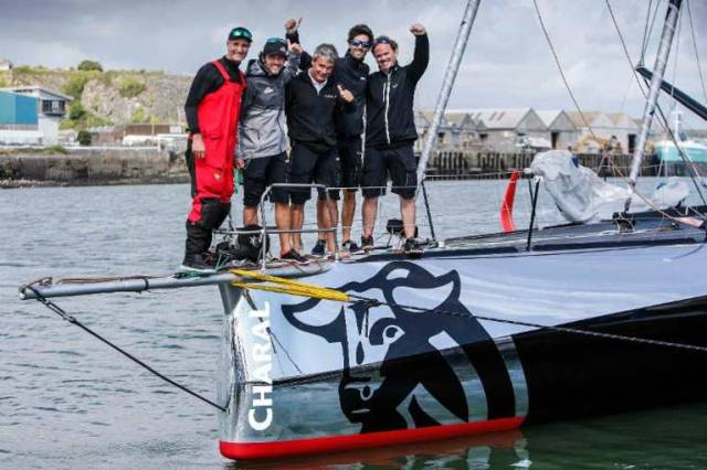 IMOCA 60 line honours for Jérémie Beyou and Christopher Pratt and their shore crew after arriving in Plymouth