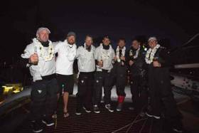 Hawaii celebrations – crew on board for the record–breaking run were: Lloyd Thornburg, Brian Thompson, Fletcher Kennedy, Justin Slattery, Pete Cumming, Henry Bomby and David Swete