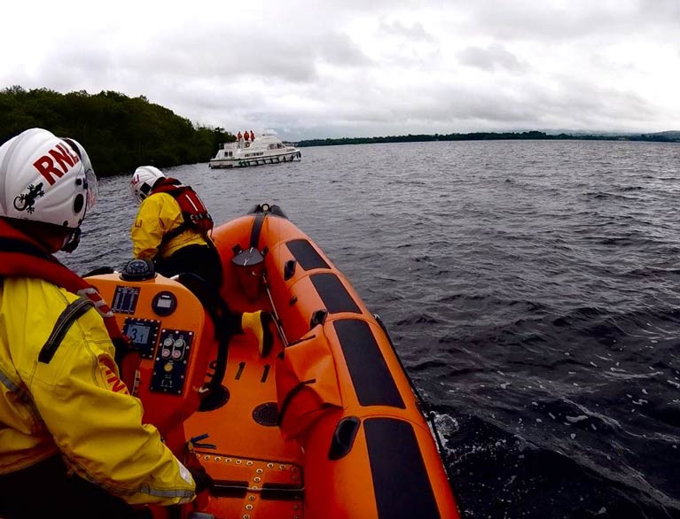 Using navigation charts and taking depth soundings, the Lough Derg lifeboat made a careful approach to the cruiser
