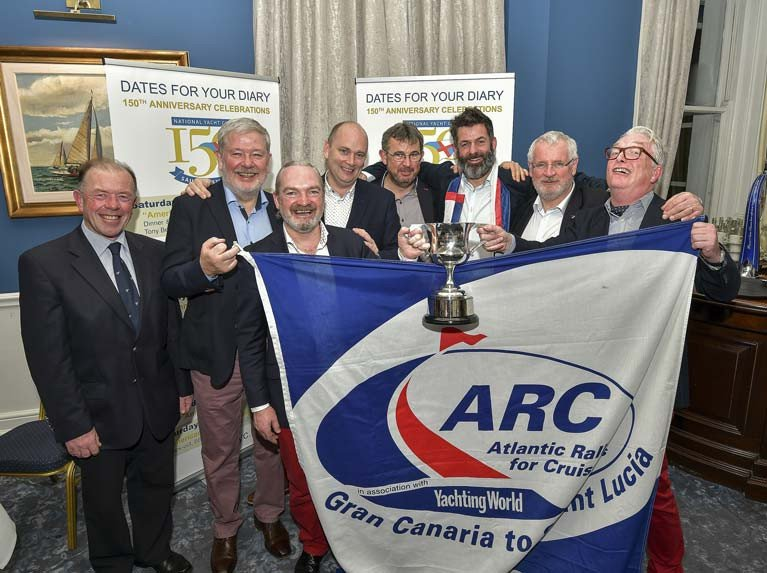 "Barry O'Sullivan and team, Paul Barrington, Alan Daly, Paul Fagan, Ted Murphy, Dave O'Reilly and Brian Uniacke, receive The Township Cup (1927). Barry and his teammates were awarded the township cup for their participation in the racing class of the Atlantic Rally Cruise (ARC) in November 2019 onboard their chartered Swan 80 ""Umiko"". Scroll down for prizegiving photos"