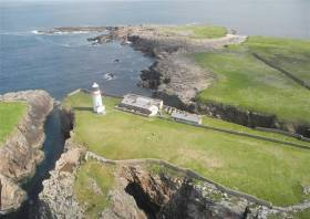 The property comprising the two cottages and outbuildings, adjacent to the now automated lighthouse on Rathlin O'Birne Island