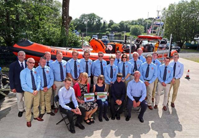 The new inshore lifeboat pictured with hew crew which is now located at Carrybridge and which has launched 13 times since going on service, was officially named Douglas, Euan & Kay Richards