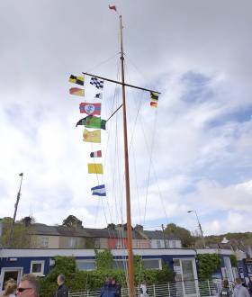 Flags on the RCYC mast indicate the fate of racing on day two of the Irish Sailing Youth Championships