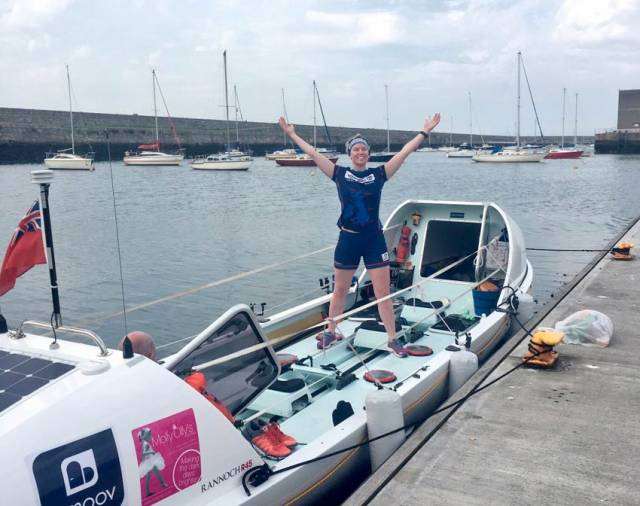 Laura Try and her custom ocean rowing boat docked in Dun Laoghaire