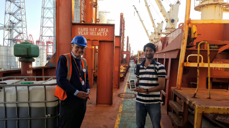 Covid19 Impact: The charity Liverpool Seafarers Centre CEO John Wilson presented an i-phone to stranded Indian seafarer, Nishanth Sadaram who had lost touch with his family after his mobile phone was damaged by seawater. The presentation took place on board the bulk-carrier M.V. Seamec Gallant where the seafarer is the 3rd officer of the 20,969grt bulk-carrier which AFLOAT adds having departed Liverpool is currently at anchorage off Moelfre on the Isle of Anglesey, north Wales.