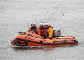 Wicklow's inshore lifeboat crew bring the casualty ashore