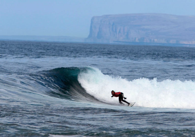 File image of a surfer at Brims Ness near Thurso in the Scottish Highlands