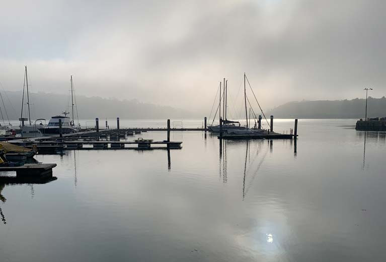 Foggy morning in Kinsale with empty berths highlighting the new marina sections