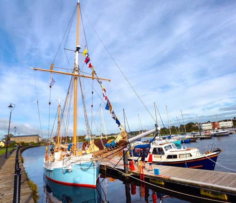 The trading ketch Ilen berthed in County Clare where traditional sail traders berthed before her, at the quayside in Kilrush