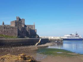 In just one week it was extremely rare for the Isle of Man to receive three cruiseships and all making an inaugural call, among them AFLOAT adds Overseas Adventure Travel's Corinthian berthed at scenic Peel on the south-west of the island.