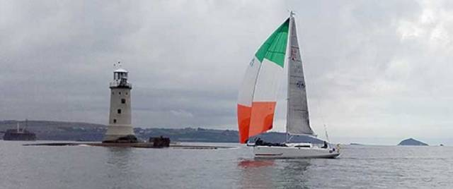 Conor Fogerty's Sunfast 3200 'Bam' crossing the line of the OSTAR qualifying race, the Solo Fastnet in 2016