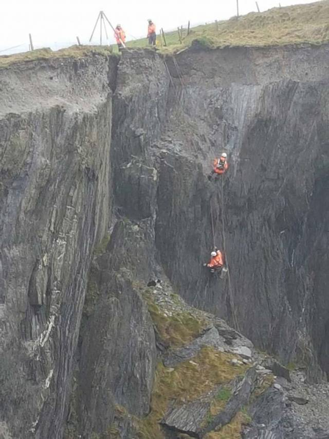 Climbers with Goleen Coast Guard attempt to retrieve the trapped dog from the cliff at Castlepoint