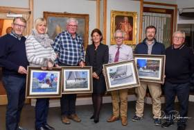 Some of the prizewinners at last night's presentation at RCYC by SCORA Commodore Johanna Murphy (centre). Scroll down for prizegiving gallery