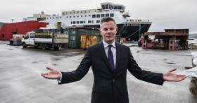 Scottish Economy Secretary, Derek Mackay, at the now newly nationalised Ferguson Marine shipyard located at Port Glasgow on the Clyde. AFLOAT adds in the background is MV Glen Sannox, the first of a pair of CalMac ferries which have incurred a huge over-run on a contract with Caledonian Maritime Assets Ltd (CMAL) ferries.