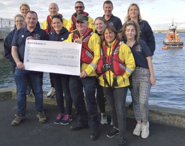 St. Michael's Rowing Club present a cheque to the RNLI at Dun Laoghaire