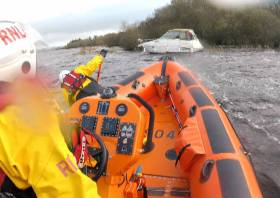 The lifeboat Douglas Euan & Kay Richards approaches the stricken vessel at an island in Upper Lough Erne